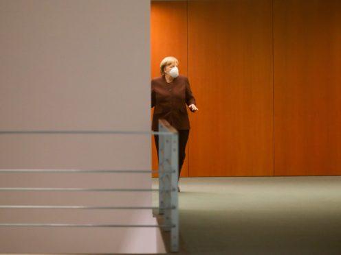 German Chancellor Angela Merkel arrives for a news conference (Markus Schreiber/AP)