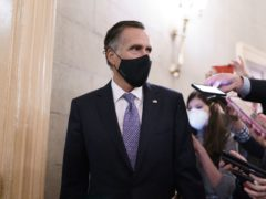 Reporters vie for a response from Senator Mitt Romney (Scott Applewhite/AP)
