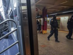 Police patrol the A line subway train bound to Inwood, after NYPD deployed an additional 500 officers into the subway system following deadly attacks (Bebeto Matthews/PA)