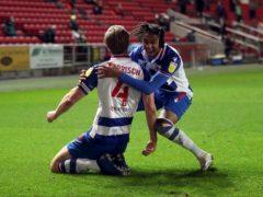 Michael Morrison celebrates scoring Reading's second goal (David Davies/PA)