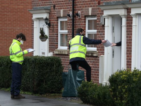 Coronavirus tests are handed out to residents in Bramley Green, Hampshire (Andrew Matthews/PA)