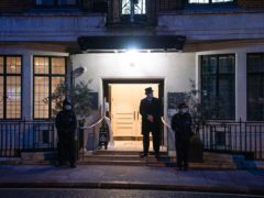 A member of hospital security staff stands outside the entrance to the King Edward VII's Hospital in London (Dominic Lipinski/PA)