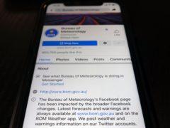 A disclaimer is shown on the bottom of Australia's Bureau of Meteorology page on the Facebook app (Kiichiro Sato/AP)