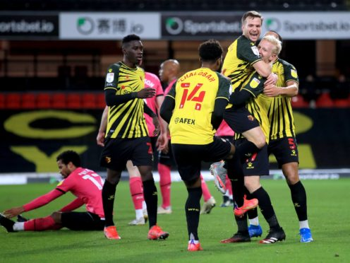Watford's Will Hughes (second right) celebrates the second goal in the defeat of his former club (Adam Davy/PA)