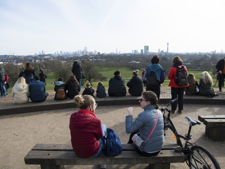 People look at the London skyline from Primrose Hill in London (Kirsty O'Connor/PA)