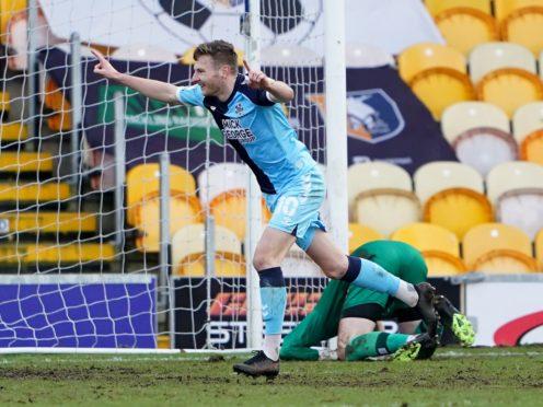 Paul Mullin celebrates scoring at Mansfield (Zac Goodwin/PA)