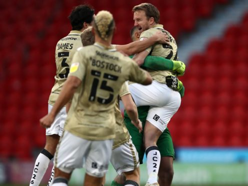 James Coppinger, right, celebrates his equaliser against Hull (Tim Goode/PA)
