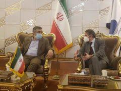 IAEA director-general Rafael Mariano Grossi, right, speaks with Iranian atomic agency official Behrouz Kamalvandi (Atomic Energy Organisation of Iran/AP)