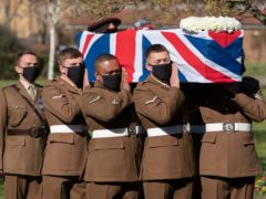 The coffin of Captain Sir Tom Moore is carried by members of the Armed Forces during his funeral at Bedford Crematorium (Joe Giddens/PA)