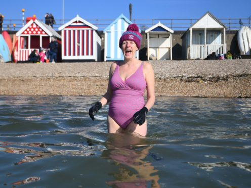 A swimmer takes to the water in Southend-on-Sea, Essex on the last weekend of February (Victoria Jones/PA)