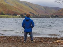 Billy Monger standing next to Lake Ullswater (Patch Dolan/Comic Relief/PA)