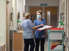 Nurses and other NHS staff are being given a 1% interim pay rise (Andrew Milligan/PA)