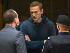 Opposition leader Alexei Navalny talks to one of his lawyers (Moscow City Court via AP/PA)