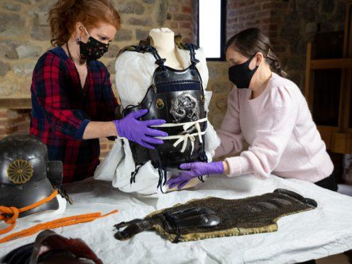 Conservators working on Samurai armour (National Trust/James Dobson/PA)