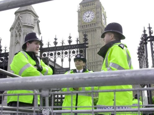 Police officers before a demonstration in London (John Stillwell/PA)