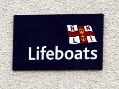 The woman was rescued by lifeboat (Paul Faith/PA)
