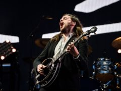 Winston Marshall, the banjo player from folk rock group Mumford & Sons, said he is 'taking time away from the band' following criticism for praising a conservative writer (Ben Birchall/PA)