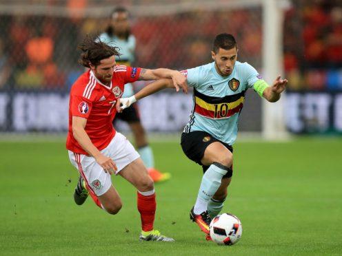 Joe Allen (left) battles Eden Hazard (right) for the ball in Wales' Euro 2016 quarter-final victory against Belgium in Lille (Mike Egerton/PA)