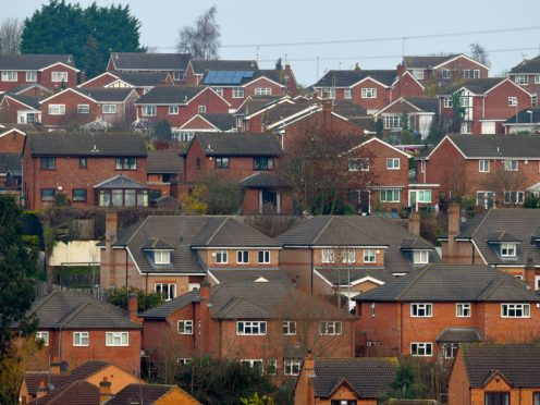 MPs have warned the failure to 'decarbonise' homes is jeopardising the Government's net zero target (Joe Giddens/PA)