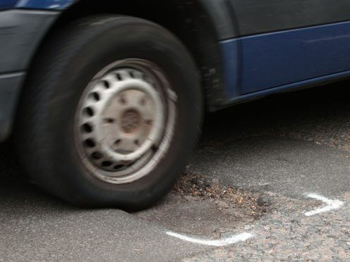 The number of potholes filled by councils in England and Wales grew by 13% in the past 12 months, new figures show (Yui Mok/PA)