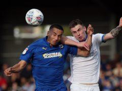 Rod McDonald (left) misses Carlisle's clash with Cambridge due to suspension (Jonathan Brady/PA).