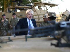 Prime Minister Boris Johnson talks to Ghurkas as he meets with military personnel on Salisbury Plain training area near Salisbury.