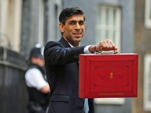 Chancellor Rishi Sunak outside 11 Downing Street, London, before heading to the House of Commons to deliver his Budget.