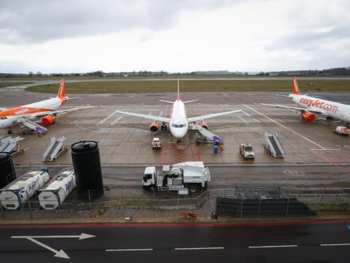 EasyJet planes sit on the tarmac at Luton Airport in Bedfordshire (Jonathan Brady/PA)