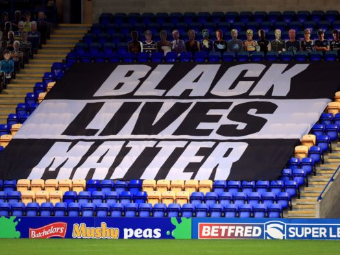 A Black Lives Matter banner in the stands during the Super League match at Warrington (Mike Egerton/PA)