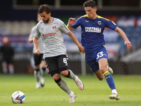 Injured AFC Wimbledon midfielder Callum Reilly, right, will miss the remainder of the season (Bradley Collyer/PA)
