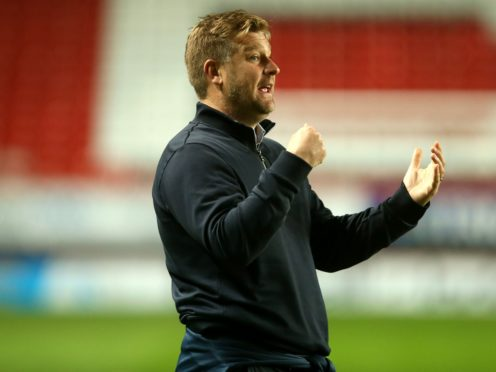 Karl Robinson's side are in play-off contention (Steven Paston/PA)