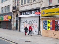 Shuttered shops on Oxford Street, London (Dominic Lipinski/PA)