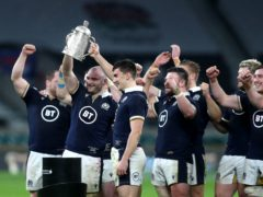 Dave Cherry, second left, lifts the Calcutta Cup after his first Scotland cap (David Davies/PA)