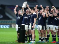 Dave Cherry (second left) celebrates with the Calcutta Cup (PA)