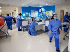 Hospital staff on a Covid-19 ward (Peter Byrne/PA)