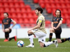 Doncaster's Jon Taylor has been ruled out for the rest of the season (Tim Goode/PA)