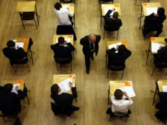 Secondary school pupils will not be sitting exams this year but will instead have grades awarded on teacher assessment (David Jones/PA)
