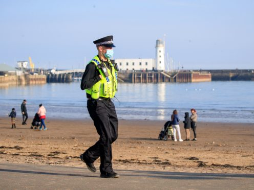 A police officer patrols the seafront in Scarborough, North Yorkshire, during England's third national lockdown to curb the spread of coronavirus. (Danny Lawson/PA)