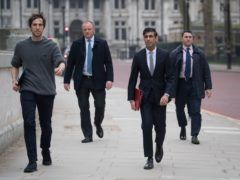 Chancellor of the Exchequer, Rishi Sunak (second right), walks from the Treasury to No 11 Downing Street, London, the day before delivering his budget (Stefan Rousseau/PA)