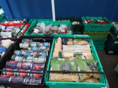 Food laid out in crates at a food bank in north London (PA)
