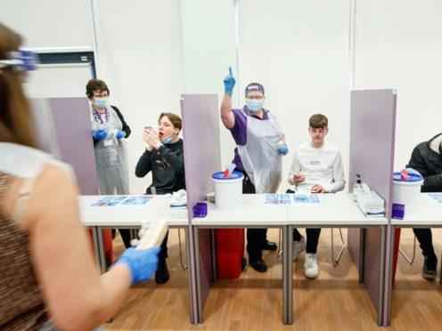 Students take Coronavirus lateral flow tests (PA)