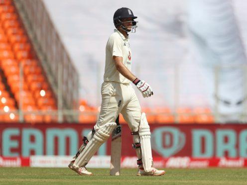 England captain Joe Root walks off the field after being dismissed (Aijaz Rahi/AP)