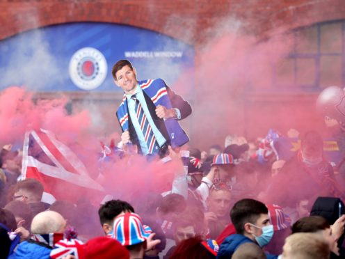 Thousands of Rangers fans broke lockdown rules to celebrate their side winning the Scottish Premiership, putting the Old Firm match in jeopardy (Jane Barlow/PA)