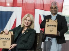 Actress Joanna Lumley with Sujan Katuwal, the owner of Nepalese restaurant Panas Gurkha in Lewisham (Ian West/PA)