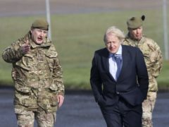 Prime Minister Boris Johnson is greeted by Brigadier Chris Davies, Commander 38 (Irish) Brigade, during a visit to Joint Helicopter Command Flying Station Aldergrove in Northern Ireland (Peter Morrison/PA)