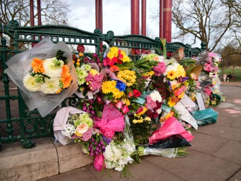 Flowers left at the bandstand on Clapham Common, after a body found hidden in woodland in Kent was identified as that of 33-year-old Sarah Everard (Ian West/PA)