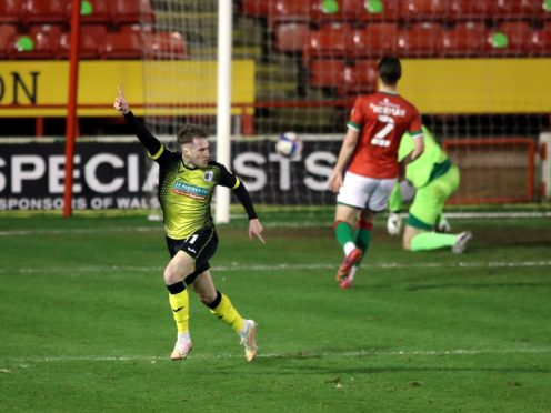 Barrow midfielder Josh Kay, celebrating, had to serve a one-match ban at the weekend (Nick Potts/PA)