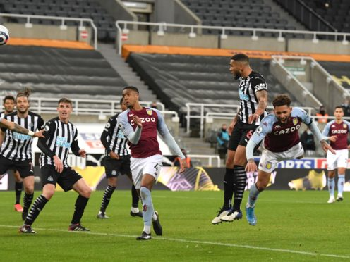 Newcastle's Jamaal Lascelles, second right, scores a late equaliser against Aston Villa (Stu Forster/PA)