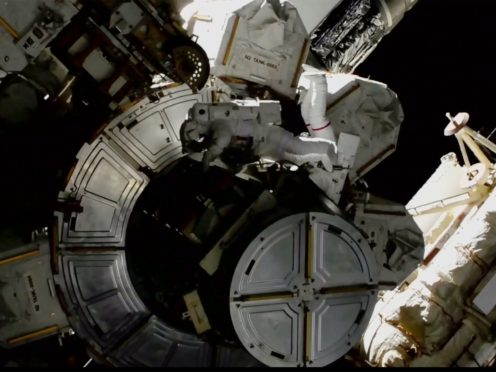 Victor Glover and Mike Hopkins on a spacewalk outside the International Space Station (Nasa/AP)