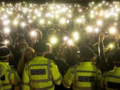 People in the crowd at the Sarah Everard vigil on Clapham Common, south London on March 13 (Victoria Jones/PA)